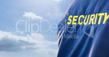Security text on uniform against sky