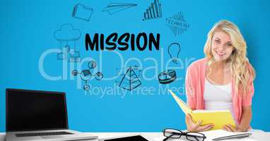 Businesswoman holding book by mission text surrounded by graphics