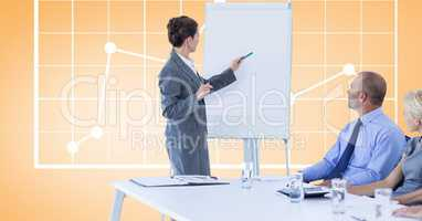 Businesswoman giving presentation to colleagues against graph