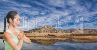 Double exposure of woman meditating at lakeshore