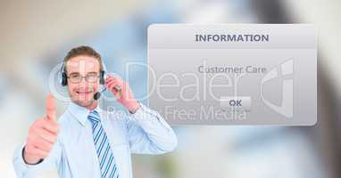 Customer support executive showing thumbs up by dialog box