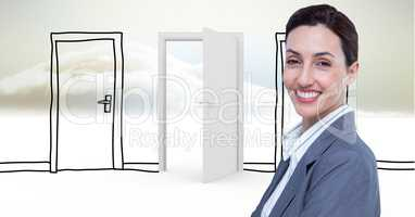 Smiling businesswoman against drawn and real doors