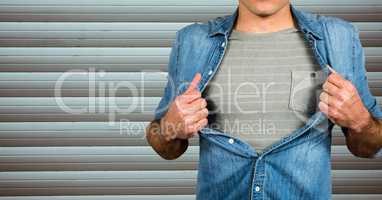Midsection of man tearing shirt