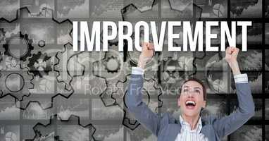 Happy businesswoman with arms raised looking at improvement text