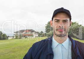 Portrait of security guard against house