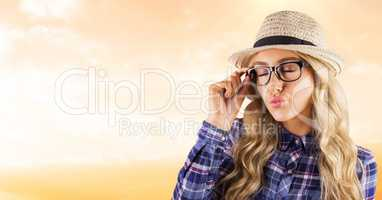 Female hipster wearing eyeglasses while puckering lips