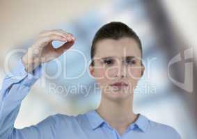 Confident businesswoman gesturing over blurred background