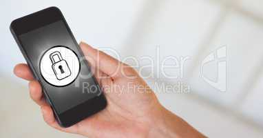 Hand with phone and white lock icon with flare against white background