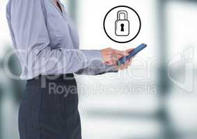 Business woman with tablet and white lock graphic against blurry office