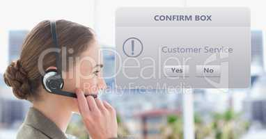 Customer service representative using headset by dialog box
