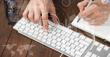 Digitally generated image of hands using computer keyboard while writing