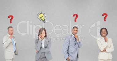 Thoughtful business people with question marks and light bulb marks on wall