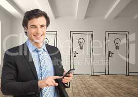 Businessman using smart phone against drawn doors