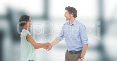 Business people shaking hands against blurred background