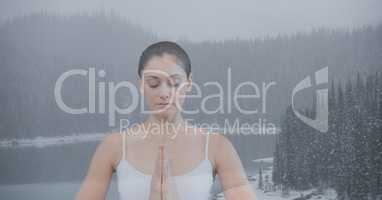 Double exposure of woman meditating in nature