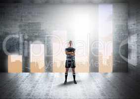 Sportsman standing arms crossed against graph shape doorways