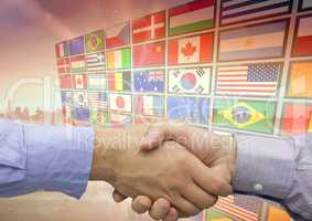 panel with flags in the city,shaking the hand each other