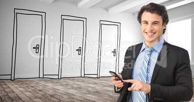 Smiling businessman using smart phone against drawn doors