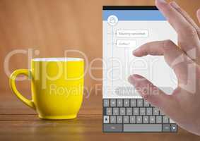 Hand Touching Social Media Messenger App Interface with coffee
