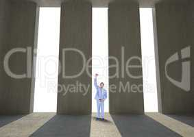 Successful businessman standing against columns