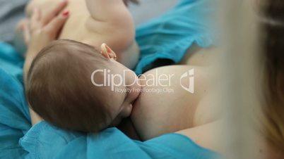 Little baby girl breast feeding