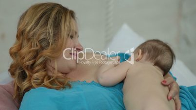 Affectionate woman caressing her infant child
