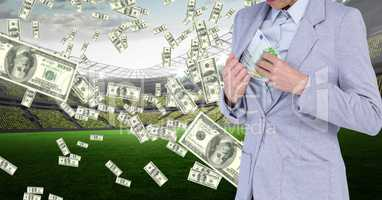 Businesswoman hiding money in jacket at football stadium representing corruption