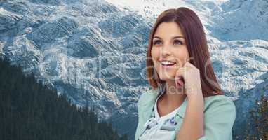 Smiling woman against snowcapped mountain
