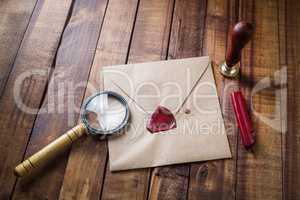 Envelope, magnifier, seal