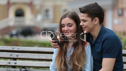 Romantic couple watching video on smartphone