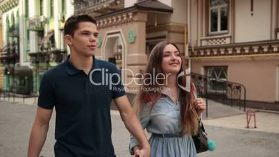 Happy young dating couple in love walking in city