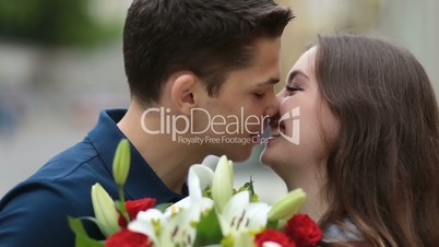 Young couple deeply in love sharing romantic kiss
