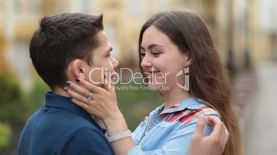 Cheerful young couple in love smiling outdoors