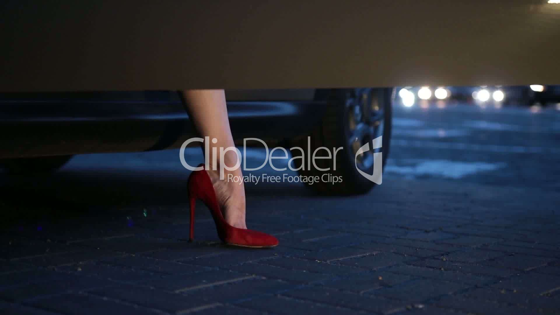 b7fbfdaae23 Woman s legs in heels stepping out of car at night  Royalty-free ...