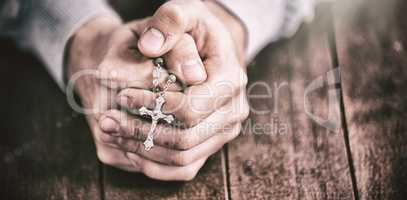Man praying with rosary
