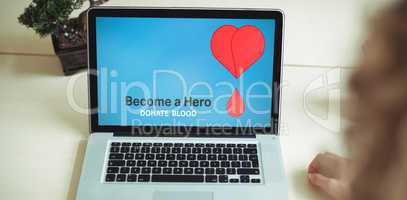 Composite image of become a hero text with heart shape on blue screen