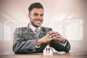 Composite image of estate agent smiling
