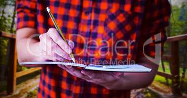 Composite image of hipster taking notes on notebooks