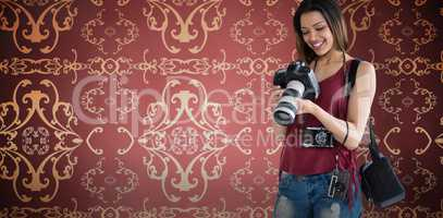 Composite image of smiling young woman holding digital camera