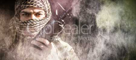 Composite image of portrait of soldier holding a rifle