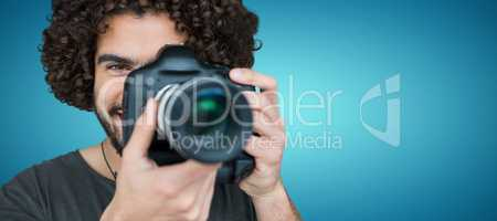 Composite image of close up portrait of male photographer taking picture