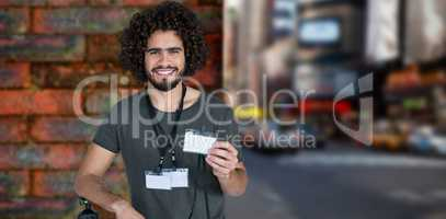 Composite image of portrait of smiling male photographer holding identity card