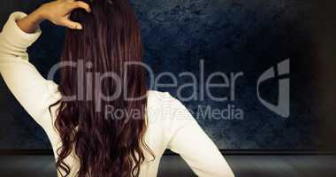 Composite image of rear view of confused woman with hand in hair