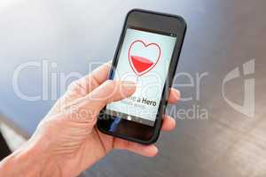 Composite image of become a hero text with heart shape on screen