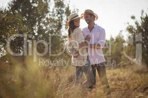 Happy young couple embracing at olive farm