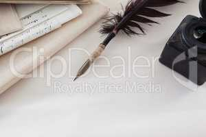 Quill feather, ink bottle and legal documents arranged on white background