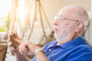 Senior Adult Man Using Smart Cell Phone.