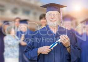 Proud Senior Adult Man In Cap and Gown At Outdoor Graduation Cer