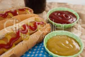 Hot dog and sauces on brown paper