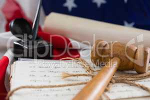 Gavel and legal documents arranged on American flag